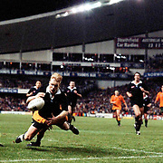 'That Tackle'. One of the most famous tackles in Rugby Union history as George Gregan makes a last minute match winning tackle on New Zealand player Jeff Wilson during the Australia V New Zealand Bledisloe cup match. Australia's George Gregan produced the try-saving tackle to deny New Zealand's Jeff Wilson in a thrilling Bledisloe Cup clash in Sydney. Ace poacher Wilson had beaten three defenders and was headed for the line but the scrum-half hurled himself at the winger and dislodged the ball to save his side and ensure a 20-16 victory. Tries from Jason Little and Phil Kearns and four kicks from fly-half David Knox had put the Wallabies in control with Shane Howarth scoring all of New Zealand's points on the day. Sydney Football Stadium, 17th August 1994. Photo Tim Clayton...RUGBY UNION N ZEALAND V AUSTRALIA..GEORGE GREGAN MAKES MATCH WINNING TACKLE ON JEFF WILSON