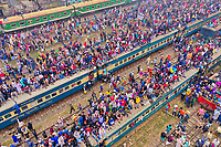 Gazipur, Bangladesh - 12 January 2020: Aerial view of a large congregation of people for a muslim festival on the top of trains at train station in Dhaka, Bangladesh.