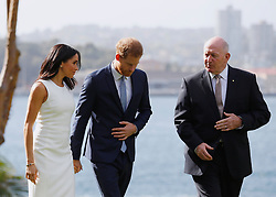 The Duke and Duchess of Sussex with Australia's Governor General Peter Cosgrove in the grounds of Admiralty House in Sydney on the first day of the royal couple's visit to Australia.