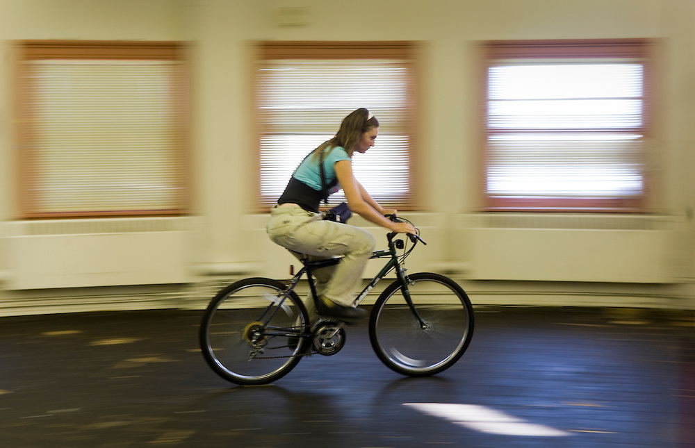Lisa Bray takes a newly assembled bike for a test run to check the shifting.