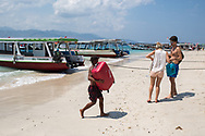 Tourists and locals in the Gili Islands in Indonesia.<br /> Photo shows Gili Trawangan Island, the largest of the three islands.