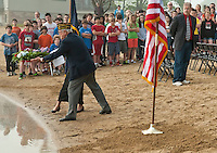 Commander of Post 1, American Legion Doris Brady and Commander of Laconia Veterans of Foreign Wars Post 1670, Don Doherty lay the wreath during the Laconia Middle School's Memorial Day Service Friday morning.  (Karen Bobotas/for the Laconia Daily Sun)