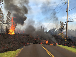 May 5, 2018 - Leilani Estates, Hawaii, U.S. - At 7:45 a.m. HST, today, lava from fissure 7 slowly advanced to the northeast on Hookapu Street in Leilani Estates subdivision on Kilauea Volcano's lower East Rift Zone. Fresh volcanic eruptions on the southern end of the island of Hawaii after a series of tremors left residents displaced and frightened as the authorities evacuated the state's largest park on Friday and worked to keep people out of two subdivisions that had been evacuated. (Credit Image: ? USGS/ZUMA Wire/ZUMAPRESS.com)