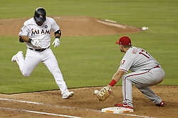 August 31, 2017 - Miami, FL, USA - The Miami Marlins' Tomas Telis, left, is out on batter interference during the eighth inning against the Philadelphia Phillies at Marlins Park in Miami on Thursday, Aug. 31, 2017. The Phillies won, 3-2. (Credit Image: © David Santiago/TNS via ZUMA Wire)