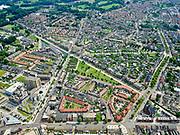 Nederland, Overijssel, Gemeente Enschede; 21–06-2020; overzicht van de woonwijk Roombeek, herbouwd na de vuurwerkramp (S.E. Fireworks). <br /> Diagonaal de Lonneker Spoorlaan, linksboven rechtsonder  (een van de drie assen van Roombeek) met in het groen Monument Vuurwerkramp Enschede (Tollensstraat).<br /> Overview of the residential area of Roombeek, rebuilt after the fireworks disaster (S.E. Fireworks).<br /> On the lawn in the middle the Enschede Fireworks Disaster Monument (Tollensstraat)<br /> <br /> luchtfoto (toeslag op standard tarieven);<br /> aerial photo (additional fee required)<br /> copyright © 2020 foto/photo Siebe Swart