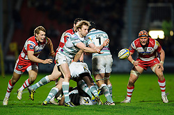 London Irish Scrum-Half (#9) Patrick Phibbs passes from the breakdown as Gloucester Inside Centre (#12) Billy Twelvetrees (L) challenges him during the second half of the match - Photo mandatory by-line: Rogan Thomson/JMP - Tel: Mobile: 07966 386802 05/01/2013 - SPORT - RUGBY - Kingsholm Stadium - Gloucester. Gloucester Rugby v London Irish - Aviva Premiership.