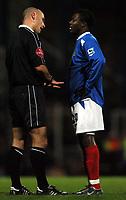 Photo: Javier Garcia/Back Page Images<br />Portsmouth v Arsenal, FA Barclays Premiership, Fratton Park, 19/12/04<br />Referee Howard Webb ticks Yakubu off for a nasty looking tackle on Manuel Almunia