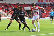 Doncaster Rovers forward John Marquis (9) under attack from Portsmouth FC midfielder Jamal Lowe (10) during the EFL Sky Bet League 1 match between Doncaster Rovers and Portsmouth at the Keepmoat Stadium, Doncaster, England on 25 August 2018.Photo by Ian Lyall.