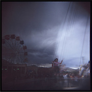 Girls ride a swing carousel in a temporary amusement park in Kabul.