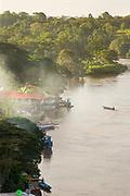 Fishermen in boats in San Juan River and the waterfront of El Castillo town, Rio San Juan Department, Nicaragua