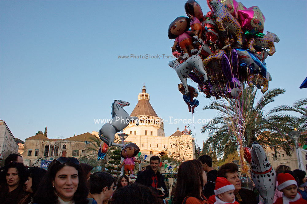 Israel, Galilee, Nazareth, The Christmas parade December 24th 2007 The Church of of the Annunciation in the background