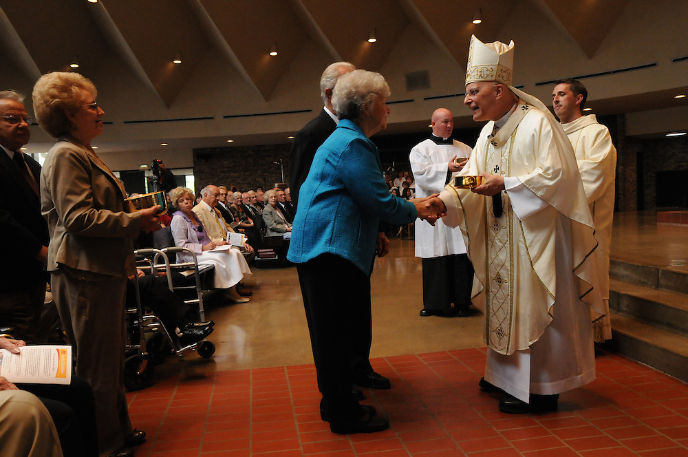 Francis Cardinal George receives the gifts of a mass honoring nearly 350 couples celebrating their 50th wedding anniversary in 2010 at St. John Brebeuf Parish in Niles.