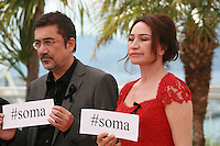Director Nuri Bilge Ceylan and actress Demet Akbağ at the photocall for the film Winter Sleep (Palme d'Or winner) at the 67th Cannes Film Festival, Friday 16th May 2014, Cannes, France
