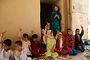 Balkh province Afghanistan. Samarkand-Dion. Children's centre, extra education. Children with their hands up.