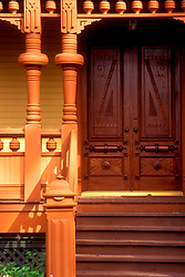 Stock photo of a close up of a porch and ornate wooden front doors
