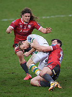 Rugby Union - 2020 / 2021 Gallagher Premiership - Gloucester vs Northampton Saints - Kingsholm<br /> <br /> Northampton Saints' Rory Hutchinson is tackled by Gloucester's Mark Atkinson and Jordy Reid.<br /> <br /> COLORSPORT/ASHLEY WESTERN