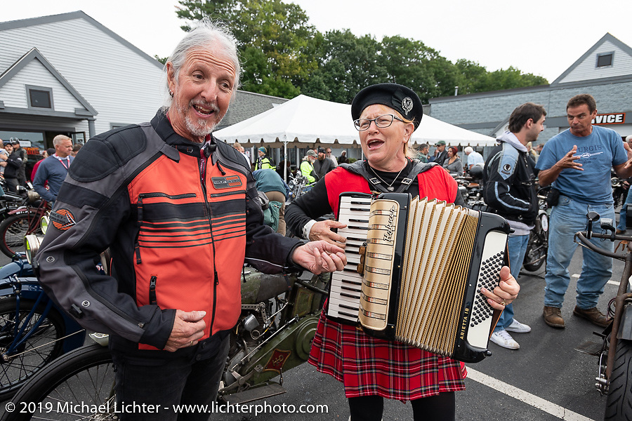 Pat Simmons of the Doobie Brothers having fun with rocket scientist (no joke) and Cajun accordionist Celia Williams at Big Moose Harley-Davidson for the start of the Motorcycle Cannonball coast to coast vintage run. Stage-1 (145-miles) from Portland, Maine to Keene, NH. Saturday September 8, 2018. Photography ©2018 Michael Lichter.