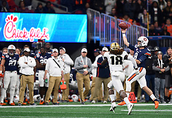 Auburn Tigers quarterback Jarrett Stidham (8) throws under pressure from UCF Knights linebacker Shaquem Griffin (18) during the Chick-fil-A Peach Bowl NCAA college football game January 1, 2018, in Atlanta. (David Tulis via Abell Images for Chick-fil-A Peach Bowl)