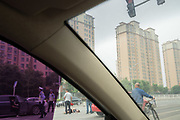 An accident on the highway injures a motorbike rider<br /><br />Huge construction and recently built tower blocks in Tongzhou city on the outskirts of Beijing. All the old buildings, villages have been destroyed to make way for the mega cities of today