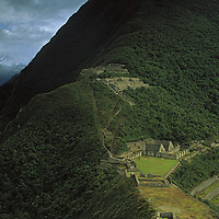 Cloud forests surround remote Choquequirau, an ancient Inca royal center in Peru's Cordillera Vilcabamba, not far from Machu Picchu.  This was discovered by Hiram Bingham in 1909, two years before Bingham found the latter.  Only recently has it begun to be restored or visited.