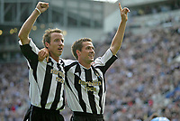 Photo: Andrew Unwin.<br />Newcastle United v Manchester City. The Barclays Premiership. 24/09/2005.<br />Newcastle's Michael Owen (R) celebrates his first goal at St James' Park with Lee Bowyer (L).
