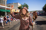 30 JUNE 2012 - PRESCOTT, AZ: A woman in a pioneer dress marches in the Prescott Frontier Days Rodeo Parade. The parade is marking its 125th year. It is one of the largest 4th of July Parades in Arizona. Prescott, about 100 miles north of Phoenix, was the first territorial capital of Arizona.    PHOTO BY JACK KURTZ