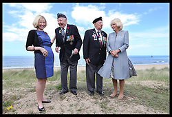 Image ©Licensed to i-Images Picture Agency. The Duchess of Cornwall and Laureen Harper the wife of the Canadian Prime Minister meet veterans Lloyd Bentley (93) and Stanley Clarkefields (95)  on Juno Beach in Normandy, France, on the eve of the 70th anniversary of DDay, Thursday, 5th June 2014 Picture by Stephen Lock / i-Images