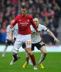 Nottingham Forest Defender Elliott Ward (ENG) vies with Derby Forward Conor Sammon (IRL) during the second half of the match - Photo mandatory by-line: Rogan Thomson/JMP - Tel: Mobile: 07966 386802 19/01/2013 - SPORT - FOOTBALL - Pride Park - Derby. Derby County v Nottingham Forest - npower Championship. The meeting of these two local sides is known as the East Midlands Derby with the winner claiming the Brian Clough Trophy.