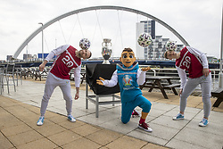 Handout photo provided by JSHPIX of the UEFA Euro 2020 Trophy at Clyde Arc in Glasgow with tournament mascot Skillizy and freestyler footballers. Picture date: Thursday June 3, 2021.