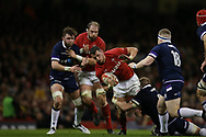 Aaron Shingler of Wales © hand's off Scotland's Murray McCallum (18) as he is tackled by Scotland's John Barclay. Wales v Scotland, NatWest 6 nations 2018 championship match at the Principality Stadium in Cardiff , South Wales on Saturday 3rd February 2018.<br /> pic by Andrew Orchard, Andrew Orchard sports photography