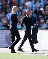 Arsenal's Arsene Wenger with Manchester City's Pep Guardiola during the FA Cup Semi Final match at Wembley Stadium, London. Picture date: April 23rd, 2017. Pic credit should read: David Klein/Sportimage
