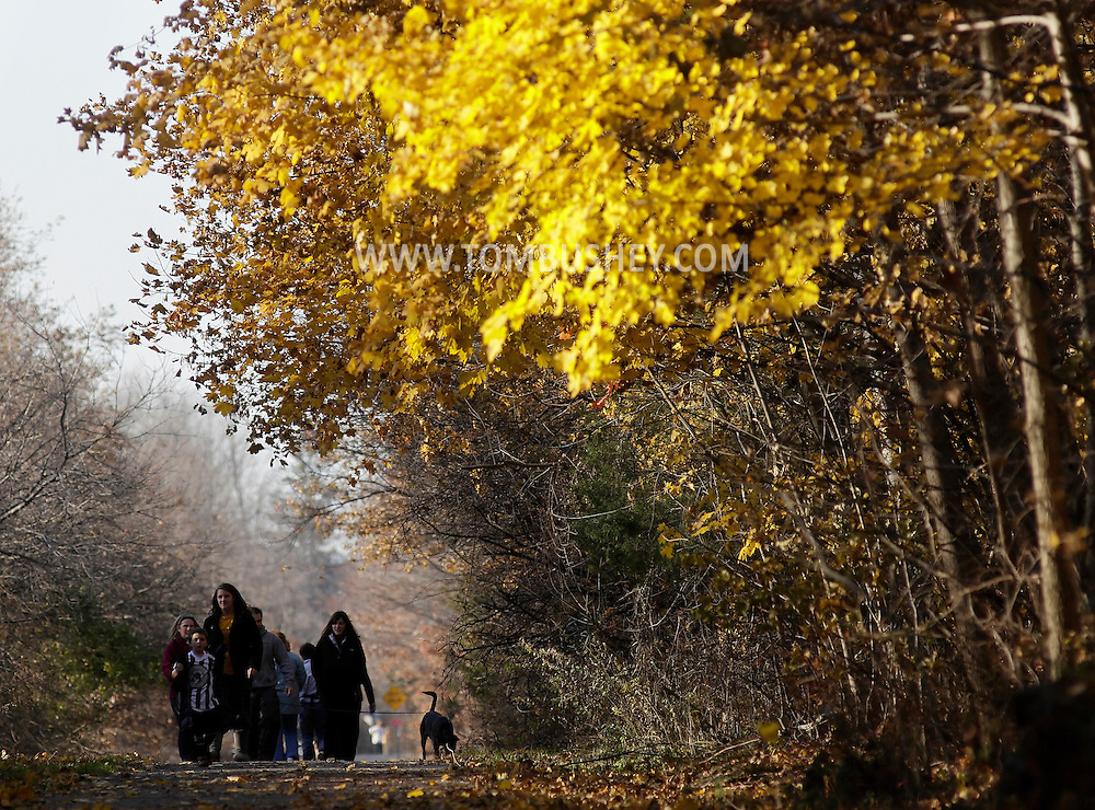 Chester, New York - People and a dog walk on the Heritage Trail on Nov. 12, 2011.