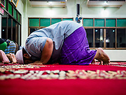 16 MAY 2018 - BANGKOK, THAILAND: Men participate in evening prayers on the first night of Ramadan at Masjid (Mosque) Darul Falah, a small mosque in Baankrua, the oldest Muslim neighborhood in Bangkok. Based on the sighting of the new moon, Ramadan fasting starts on Thursday, 17 May in Thailand.      PHOTO BY JACK KURTZ