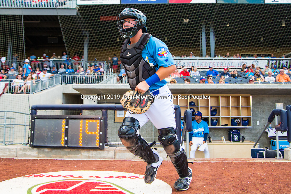Amarillo Sod Poodles catcher A.J. Kennedy (8) takes the field against the Northwest Arkansas Travelers on Sunday, July 21, 2019, at HODGETOWN in Amarillo, Texas. [Photo by John Moore/Amarillo Sod Poodles]