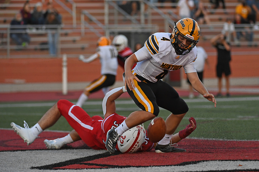 Craig Sonson Jr. #4 of the Montour Spartans fumbles the ball as he is sacked in the end zone by Ryan Hazen #32 of the Moon Tigers in the first half during the game at Tiger Stadium on September 3, 2021 in Moon Township, Pennsylvania.