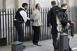© Licensed to London News Pictures. 21/09/2020. London, UK. Armed police detain a van driver in Whitehall who, it is reported, stopped outside the gates of Downing Street and said he was going to see Prime Minister Boris Johnson. He may also have had a knife. Photo credit: Peter Macdiarmid/LNP