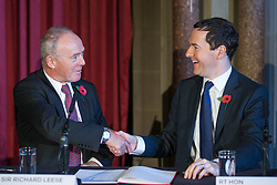 © Licensed to London News Pictures . Manchester , UK . FILE PICTURE DATED 03/11/2014 of Sir Richard Leese and The Chancellor of the Exchequer George Osborne MP at Manchester Town Hall signing a deal to devolve power to Greater Manchester , including giving the city a Mayor and greater control over its finances . Today (24th February 2015) it has been revealed that , as part of the devolution deal , Greater Manchester will gain control of its entire £6 billion NHS budget - 25% of the government's spending in the region , and all administrative control too . Photo credit : Joel Goodman/LNP