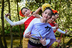 © Licensed to London News Pictures. 09/04/2017. London, UK.  Young dancers show off their traditional costumes.  Worshippers and visitors attend the Thai New Year festival of Songkran at The Buddhapadipa Temple in Wimbledon.  Traditionally, the sprinkling of water symbolises the washing away of the past, and water would have been gently poured onto elders, or images of Buddha.