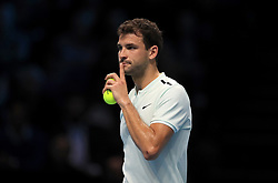 Grigor Dimitrov instructs his coach to keep quiet after a warned for a coaching violation during day four of the NITTO ATP World Tour Finals at the O2 Arena, London.
