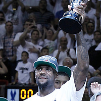 21 June 2012: Miami Heat small forward LeBron James (6) holds the MVP Finals trophy after the Miami Heat 121-106 victory over the Oklahoma City Thunder, in Game 5 of the 2012 NBA Finals, at the AmericanAirlinesArena, Miami, Florida, USA. The Miami Heat wins the series 4-1.