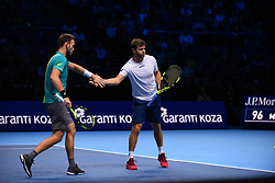 November 14, 2017 - London, England, United Kingdom - Michael Venus of New Zealand and Ryan Harrison of The United States in action during the doubles match against Nicolas Mahut of France and Pierre-Hugues Herbert of France on day three of the Nitto ATP World Tour Finals at O2 Arena on November 14, 2017 in London, England. (Credit Image: © Alberto Pezzali/NurPhoto via ZUMA Press)