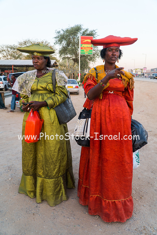 Herero women in traditional dress. The Herero, (AKA Ovaherero), are an ethnic group inhabiting parts of Southern Africa. The majority reside in Namibia, with the remainder found in Botswana and Angola. They speak Herero (Otjiherero), a Bantu language. Photographed in Namibia