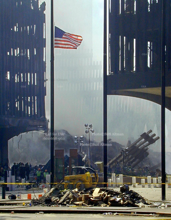 "Ground Zero New York City three days after the attack on the World Trade Center in Manhattan. Through my eyes and with my camera I am able to see the world we live in, and try to bring things into focus. Photography preserves my vision of what ""I see"" at a specific time and place- a moment. Creating a bond between  me and my subject and capturing and emotion for eternity. Having lived and worked in New York City for over 15 years when 911 happened. I had to go and ""see"" with my camera what lower Manhattan was like after this horrific attack on our Nation. The World Trade Center owned the skyline in lower Manhattan making it feel more like a canyon. After the Twin Towers fell, and I saw with my own eyes and camera the destruction, I realized what little land they actually sat on. The Twin Towers may not have occupied a large plot of land but they now touched everyones life. Photo©SuziAltman"