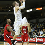 Central Florida guard A.J. Rompza (3) drives to the basket against Louisiana during their game at the UCF Arena on December 15, 2010 in Orlando, Florida. UCF won the game79-58. (AP Photo/Alex Menendez)