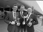 Irish Sea Angling Team.    (N84)..1981..30.06.1981..06.30.1981..30th June 1981..The Irish Sea Angling team arrived back in Dublin Airport today after The World Sea Angling competition in Amsterdam. The Irish team were placed a creditable third in the competition...Image shows members of the Irish Sea Angling Team on their arrival back in Dublin after the World Sea Angling Championship..Unfortunately we do no have the name caption sheet, If you know the members of the team why not let us know at irishphotoarchive@gmail.com and we will gladly add them to the images.