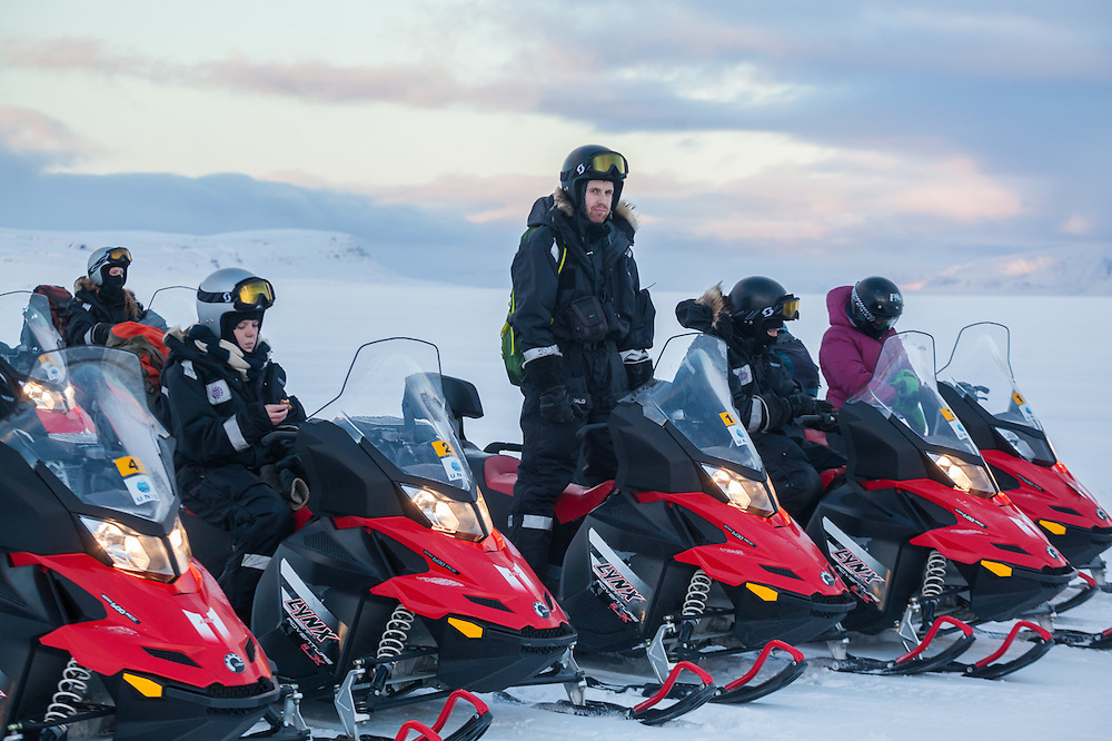 UNIS student Skafti Brynjólfsson (center) and his classmates take a break in Sassendalen, Svalbard on a class field trip by snowmobile to Rabotbreen.