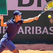 PARIS, FRANCE June 10. Shang Juncheng of China in action against Sean Cuenin of France in the quarter finals of the Junior Singles competition at the 2021 French Open Tennis Tournament at Roland Garros on June 10th 2021 in Paris, France. (Photo by Tim Clayton/Corbis via Getty Images)