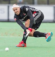BLOEMENDAAL - Justin Reid-Ross (A'dam)   Hockey hoofdklasse heren, Bloemendaal-Amsterdam (2-0) . COPYRIGHT KOEN SUYK