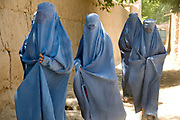 Balkh province Afghanistan. Women walk home after a meeting