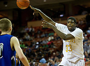 Dalyn Mumphrey (33) of Dallas Triple A Academy makes a no-look pass against Mumford during the UIL 1A division 1 state championship game at the Frank Erwin Center in Austin on Friday, March 8, 2013. (Cooper Neill/The Dallas Morning News)